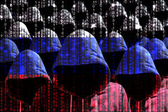 Group of hooded hackers shining through a digital russian flag. Cybersecurity concept Royalty Free Stock Photography
