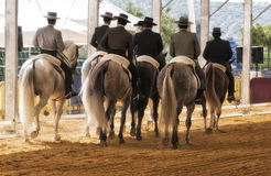 Group of horsemen riding on their backs after dressage exhibition denim in Andujar. Jaen province, Andalucia, Spain stock images