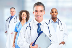 Group of hospital doctors. Group of hospital doctors over Health care clinic background stock photos