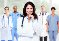 Group of hospital doctors. Group of hospital doctors over Health care clinic background stock images
