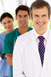 Group of hospital doctors standing in line. Smiling Stock Photos