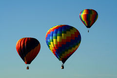 Group of hot air balloons. Colorful hot air balloons soaring in a deep blue sky Stock Images
