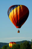 Group of hot air balloons. Colorful hot air balloons launching into a beautiful blue sky Stock Photo