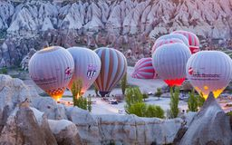 Group of hot air balloons near Goreme, Cappadocia in Turkey. Goreme, Turkey - April 18, 2016: Group of hot air balloons are preparing for take-off near Goreme Royalty Free Stock Photo