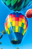 Group of hot air balloons take off from the desert Royalty Free Stock Photos