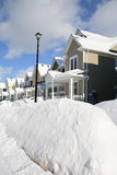 A Group of Houses After a Snow Storm with a Lamp Post in Front. A group houses on sunny winter day with lots of snow in front Stock Photography