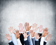 Group of Human Arms Raised with Concrete Wall Royalty Free Stock Photography