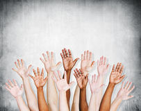 Group of Human Arms Raised with Concrete wall Stock Image