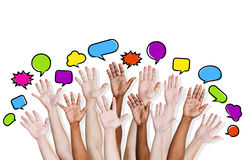 Group of Human Arms Raised with Speech Bubble.  Royalty Free Stock Image