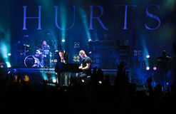 Group HURTS performs on MOST Festival 2013 July 2, 2013 in Minsk, Belarus. MINSK, BELARUS - JULY 2: Group HURTS performs on MOST Festival 2013 July 2, 2013 in Royalty Free Stock Images