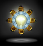 Group Ideas. And creativity partnership concept with glowing light bulbs organized in a radial pattern as a symbol of the power of working together for Royalty Free Stock Image