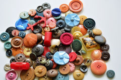 Group if old plastic vintage  buttons on white background Stock Photos