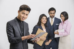 Group of Indian business people with their leader. Busy group of business people with businessman leader on foreground Stock Image