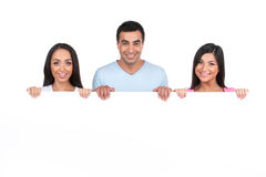 Group of Indian people standing behind blank poster. Royalty Free Stock Photography