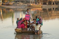Group of Indian people travelling in a boat Royalty Free Stock Image