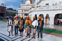 Group of Indian Sikh men in Golden Temple. Amritsar. India Stock Photo