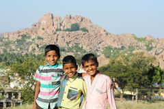 Group of Indian teen boys posing to the camera. Hampi, India - 11 January 2015: Group of Indian teen boys posing to the camera at Hampi Stock Images