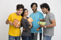 Group of Indian young friends holding gift boxes Stock Photos