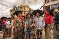 Group of indigenous kichwa men wearing chaps and sombreros Stock Photos