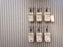 Group of individual residential natural gas meters on building Royalty Free Stock Image