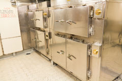 Group of industrial baking ovens on board a navy ship Royalty Free Stock Photography
