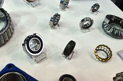 Group of industrial spherical roller bearings for use in smart factory, selective focus. Special application bearings stock image