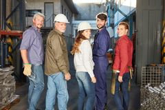 Group of industrial workers as team Royalty Free Stock Photos