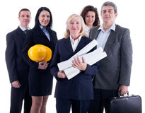 Group of industrial workers. Business team. Isolated over white Stock Images