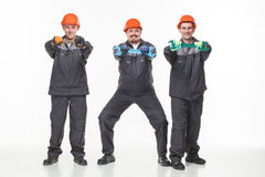 Group of industrial workers. Isolated over white background Stock Photo