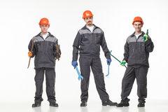 Group of industrial workers. Isolated over white background Royalty Free Stock Image