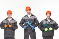 Group of industrial workers. Isolated over white background Stock Images