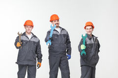 Group of industrial workers. Isolated over white background Royalty Free Stock Photos