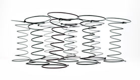 Group of Innersprings used in Upholstery. Group of Black Wire Springs used in Upholstery on white background with selective focus on the first spring Stock Image