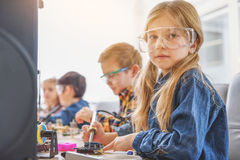 Group of interested children in workshop Stock Photo