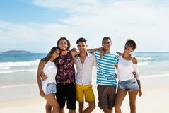 Group of international friends at beach. Outdoor in the summer royalty free stock photography
