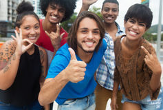 Group of international hipster young adults showing thumb Stock Photography
