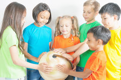 Group of international kids holding globe earth Royalty Free Stock Image