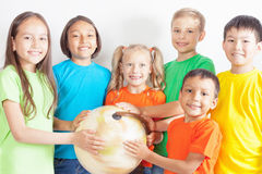 Group of international kids holding globe earth Royalty Free Stock Photography