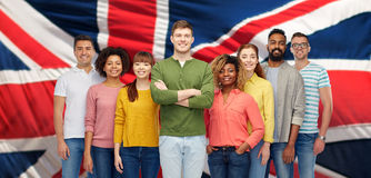 Group of international people over english flag Royalty Free Stock Photography