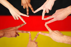 Group of international people showing peace sign Royalty Free Stock Photo