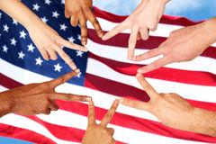 Group of international people showing peace sign Royalty Free Stock Image
