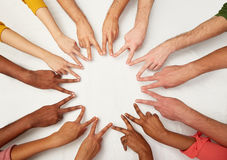 Group of international people showing peace sign. Diversity, race, ethnicity, international and people concept - group of hands showing peace hand sign Royalty Free Stock Images