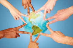 Group of international people showing peace sign Royalty Free Stock Photography