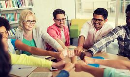 Group of international students making fist bump royalty free stock image
