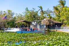 Group of international tourists leaving from the airboat pier. royalty free stock photography