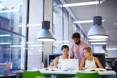 Group of international university students learning in library Stock Images
