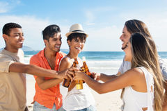 Group of international young adults making friends. At beach outdoor in the summer Royalty Free Stock Photography