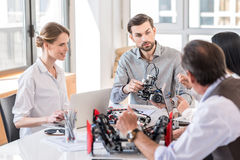 Group of inventors discussing in office Royalty Free Stock Images