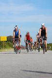 Group of Ironman triathletes cycling Stock Image