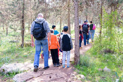 Group of Isaraeli fourth grade school kids. JERUSALEM - FEB. 11, 2017: Group of Isaraeli fourth grade school kids and their parents on a field trip in a forest Stock Photography